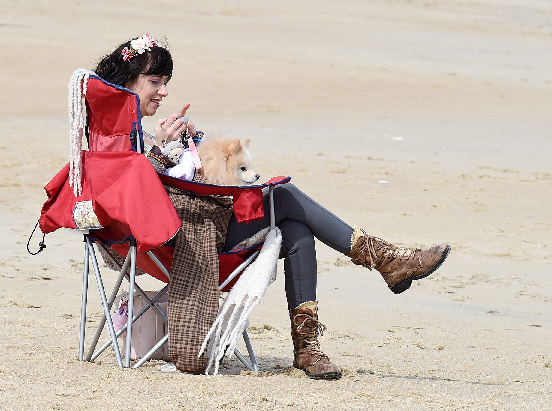 Lindsay Jenkins from Washington, D.C. enjoys the beach on 2019's first day of spring.