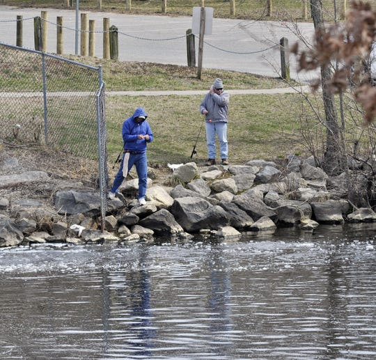 Two men enjoying the first day of spring fishing near Silver Lake Park Wednesday.