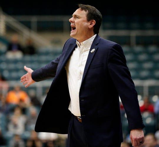 Abilene Christian coach Joe Golding shouts during the first half of the team's NCAA college basketball game against New Orleans for the Southland Conference men's tournament title Saturday, March 16, 2019, in Katy, Texas. (AP Photo/Michael Wyke)
