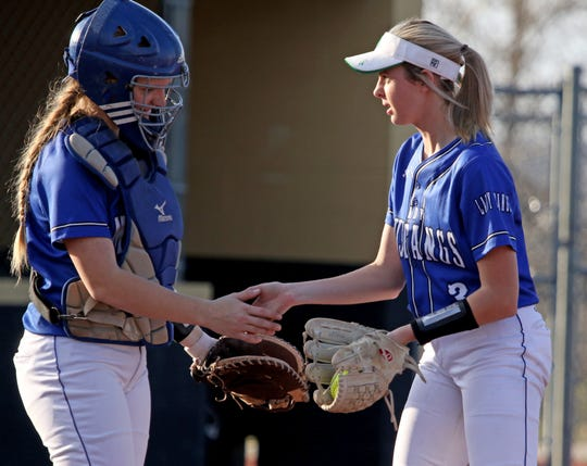 City View's Mackenzie Cave and Maddie Chalenburg meet at the pitcher's circle at the start of the bottom of the inning against Henrietta Tuesday, March 19, 2019, in Henrietta. The Lady Cats defeated the Lady Mustangs in a 4-3 walk-off.