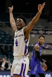 Abilene Christian guard Damien Daniels celebrates a 3-point shot in the final minute of the team's NCAA college basketball game against New Orleans for the Southland Conference men's tournament title Saturday, March 16, 2019, in Katy, Texas. (AP Photo/Michael Wyke)