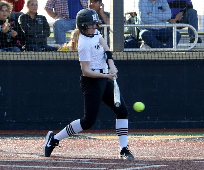 Henrietta's Camrin Byers hits a double against City View Tuesday, March 19, 2019, in Henrietta. The Lady Cats defeated the Lady Mustangs in a 4-3 walk-off.
