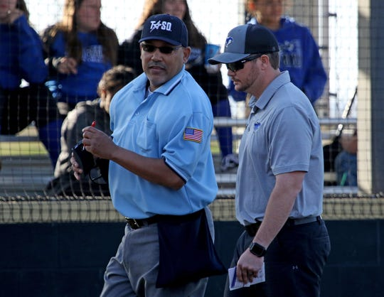 City View head softball coach Charlie Stone talks to an umpire in the game against Henrietta Tuesday, March 19, 2019, in Henrietta. The Lady Cats defeated the Lady Mustangs in a 4-3 walk-off.