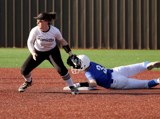 Henrietta's Kailey Barnard looks to third after City View's Maddie Chalenburg makes it to second Tuesday, March 19, 2019, in Henrietta. The Lady Cats defeated the Lady Mustangs in a 4-3 walk-off.