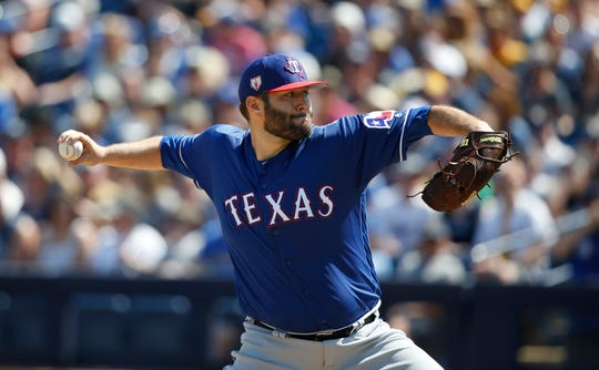 Texas Rangers starting pitcher Lance Lynn pitches in the first inning of a spring training baseball game against the Milwaukee Brewers Tuesday, March 19, 2019, in Phoenix (AP Photo/Sue Ogrocki)