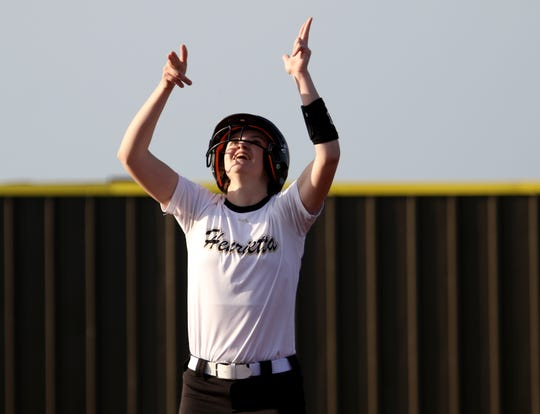 Henrietta's Camrin Byers shoots into the air to celebrate her double against City View Tuesday, March 19, 2019, in Henrietta. The Lady Cats defeated the Lady Mustangs in a 4-3 walk-off.
