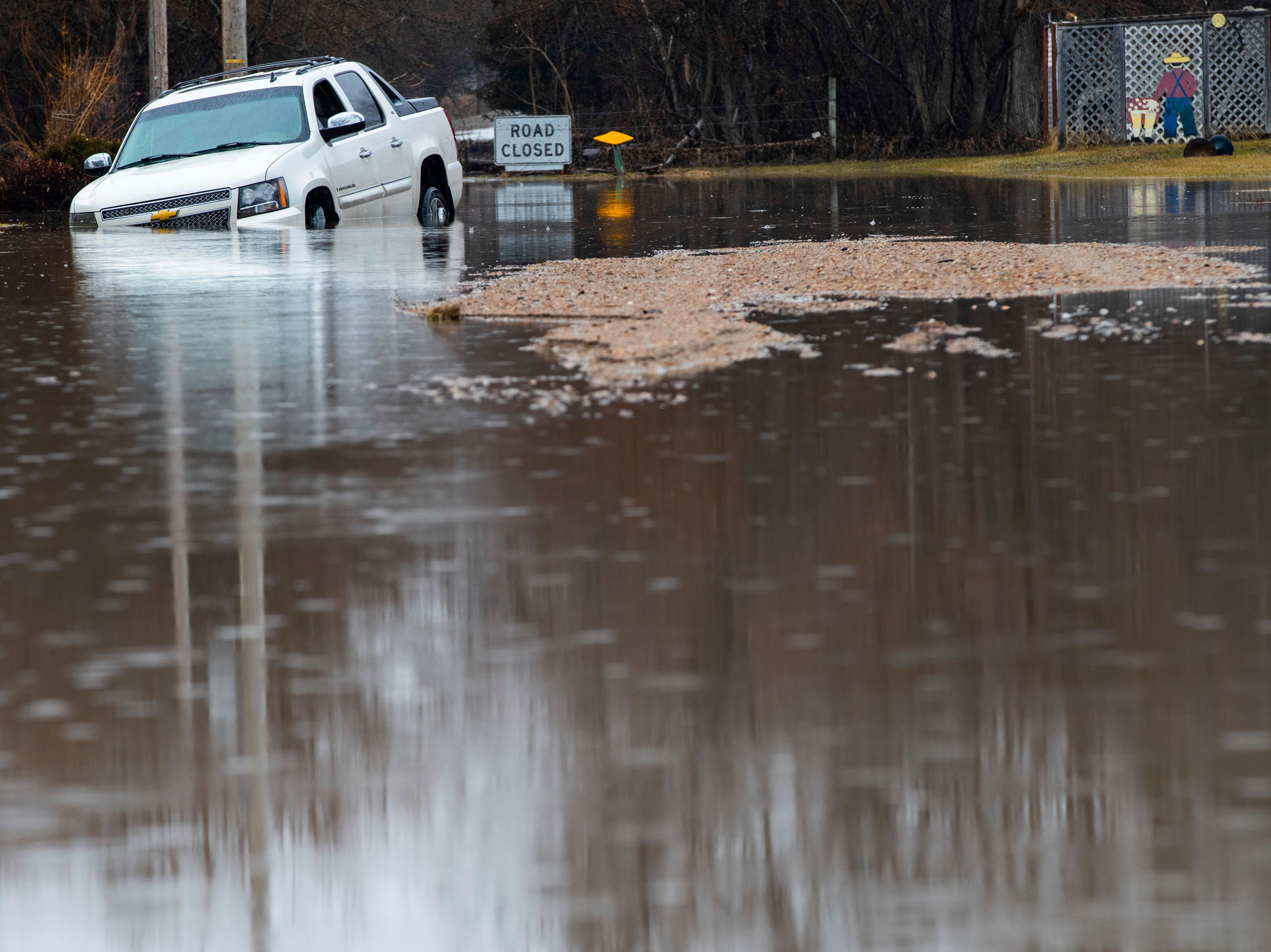 A vehicle is stuck in floodwaters Tuesday, March 19, 2019, in Fremont, Neb. Flooding is expected throughout the week in several states as high water levels flow down the Missouri River. Swollen rivers have already breached more than a dozen levees in Nebraska, Iowa and Missouri, according to the U.S. Army Corps of Engineers.