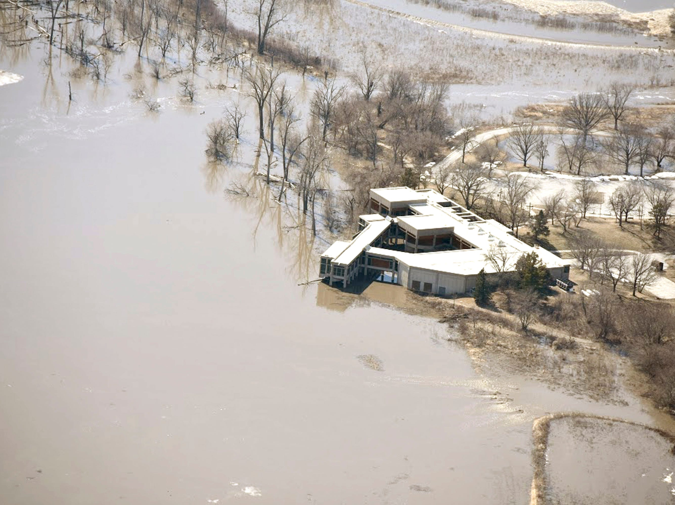 In this Monday, March 18, 2019, photo taken by the South Dakota Civil Air Patrol and provided by the Iowa Department of Homeland Security and Emergency Management, shows flooding along the Missouri River in California Junction, Iowa.