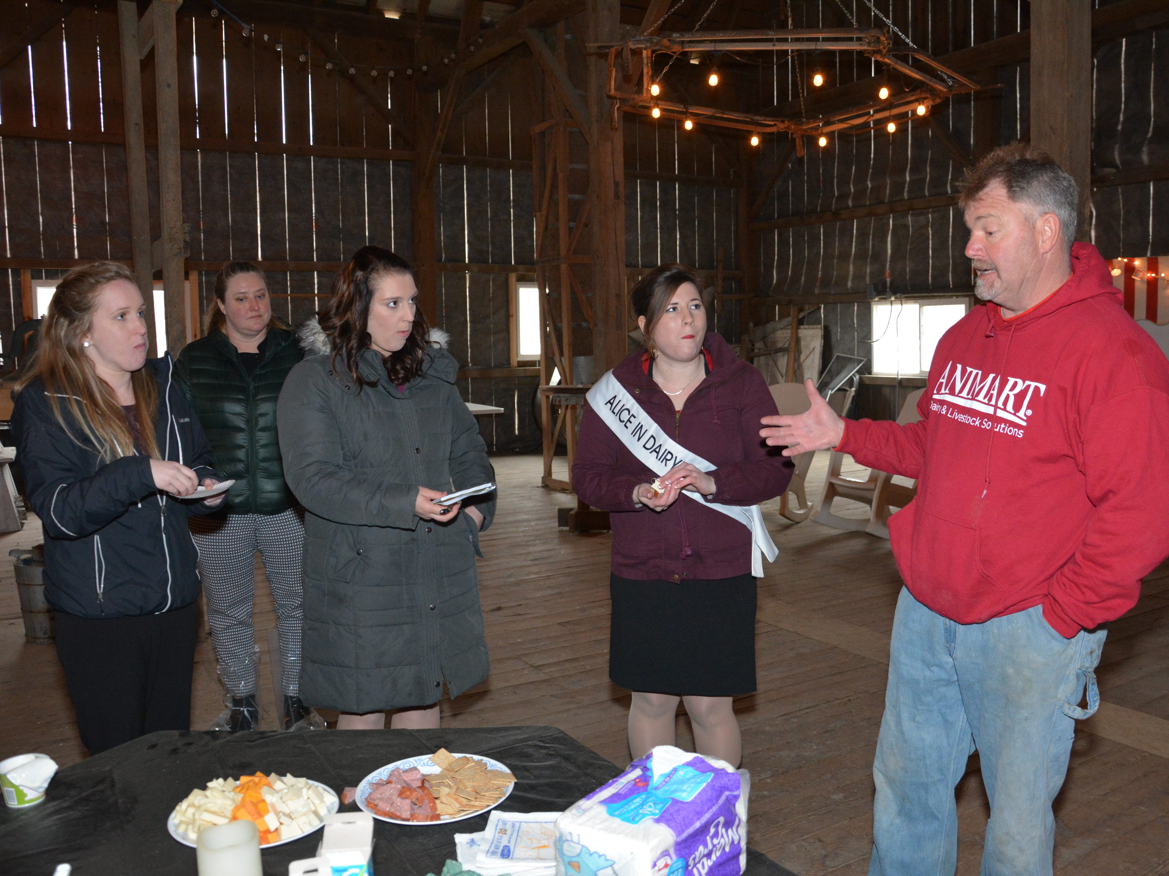Bryan Voegeli talks with the girls during the a tour of Voegeli Farms in Monticello, Wis.