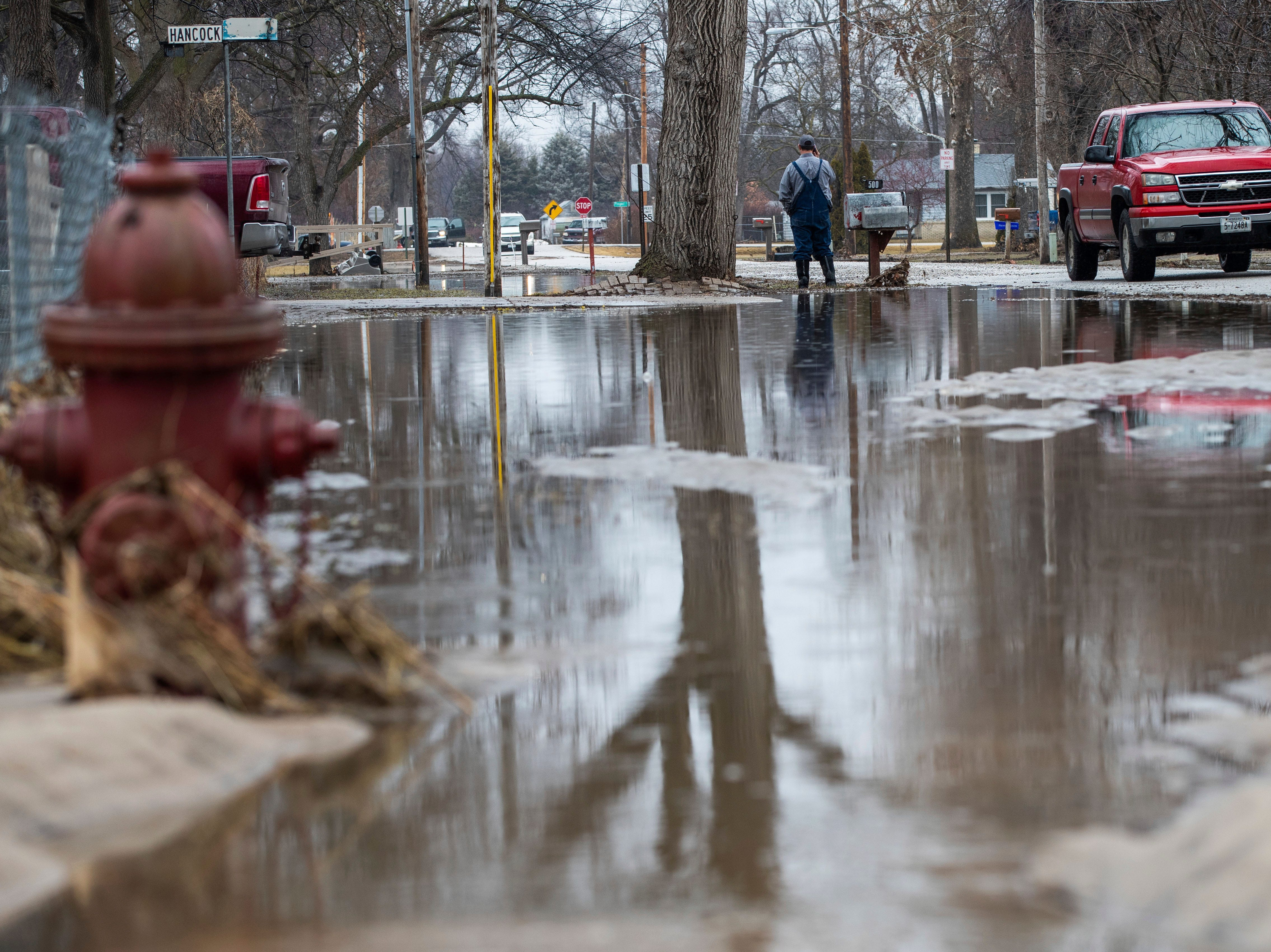 A motorist travels down Boulevard Street near a closed Ridgeland Road Tuesday, March 19, 2019, in Inglewood, Neb. Flooding is expected throughout the week in several states as high water levels flow down the Missouri River. Swollen rivers have already breached more than a dozen levees in Nebraska, Iowa and Missouri, according to the U.S. Army Corps of Engineers.