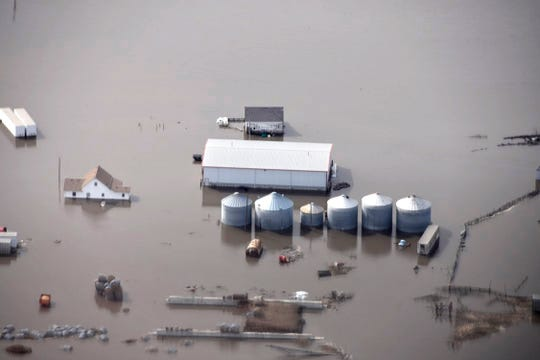 This Monday, March 18, 2019 photo taken by the South Dakota Civil Air Patrol and provided by the Iowa Department of Homeland Security and Emergency Management, shows flooding along the Missouri River in rural Iowa north of Omaha, Neb.