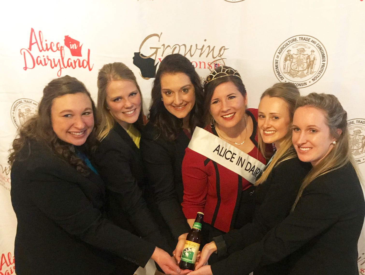 Alice in Dairyland candidates pose Kaitlyn Riley along with a bottle of the popular Spotted Cow beer brewed at New Glarus Brewery.