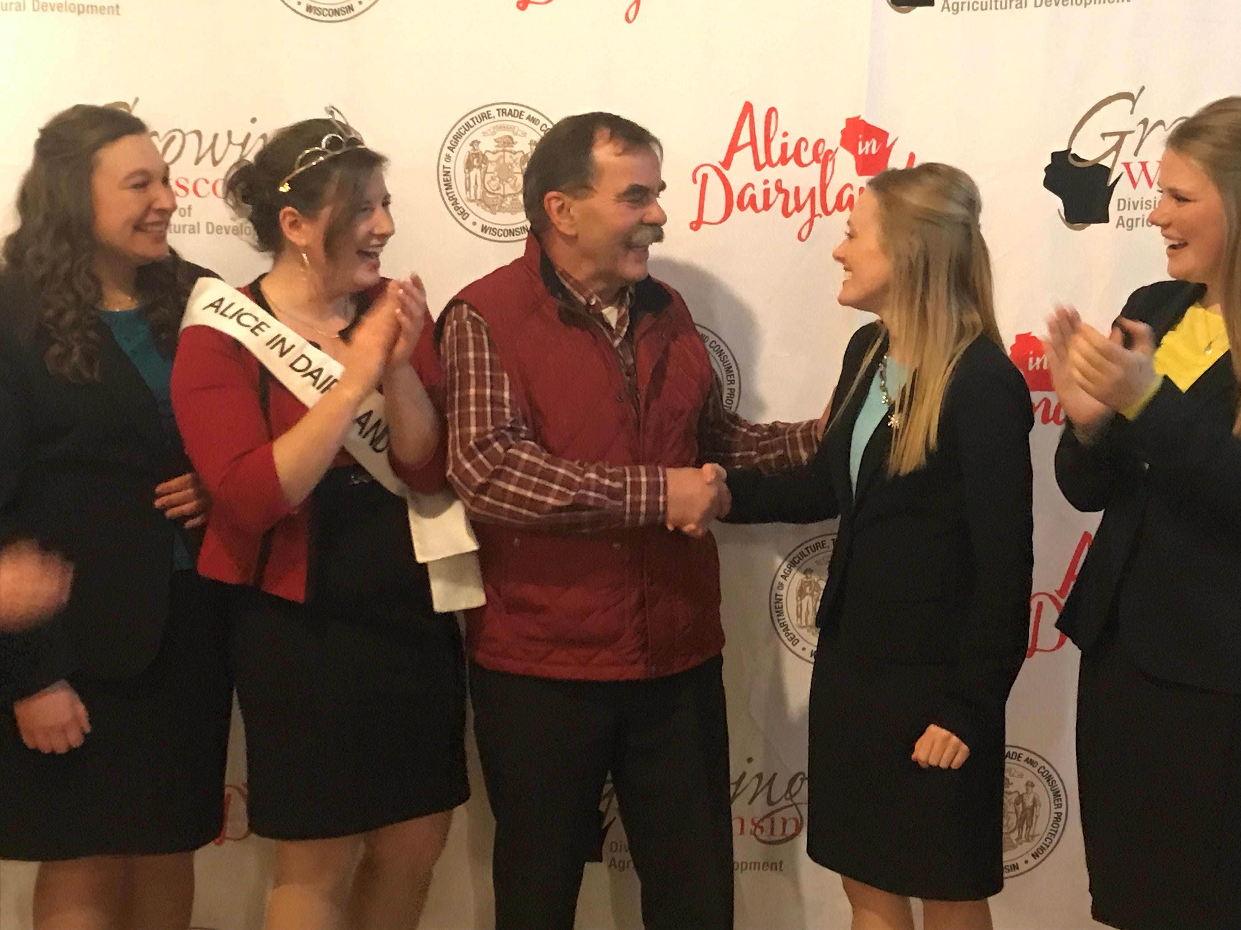 Swiss emigrant Tony Zgraggen shares his yodeling talents with the contestants  and Alice in Dairyland.
