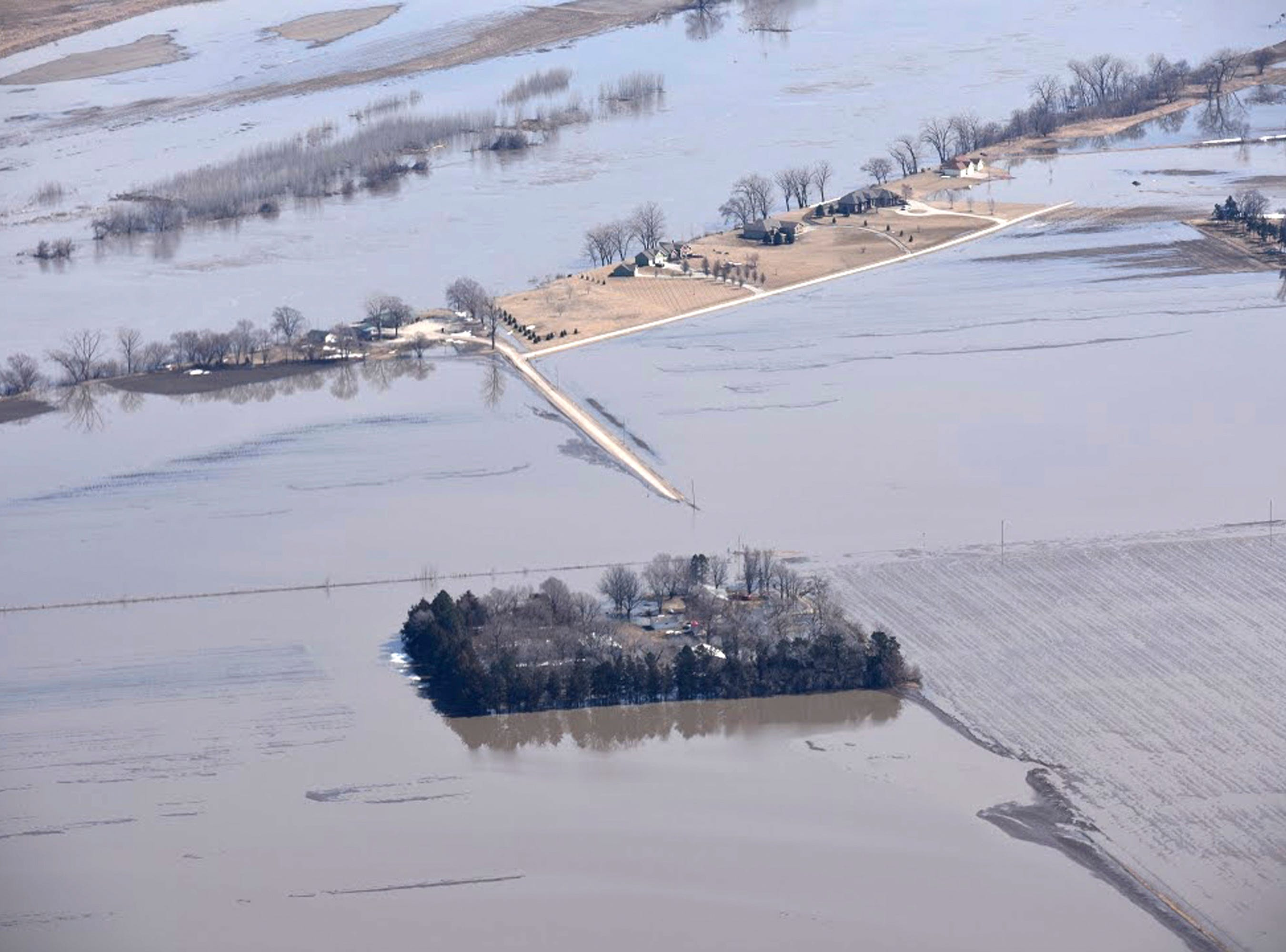 In this Monday, March 18, 2019, photo taken by the South Dakota Civil Air Patrol and provided by the Iowa Department of Homeland Security and Emergency Management, shows flooding along the Missouri River north of Blair, Neb.