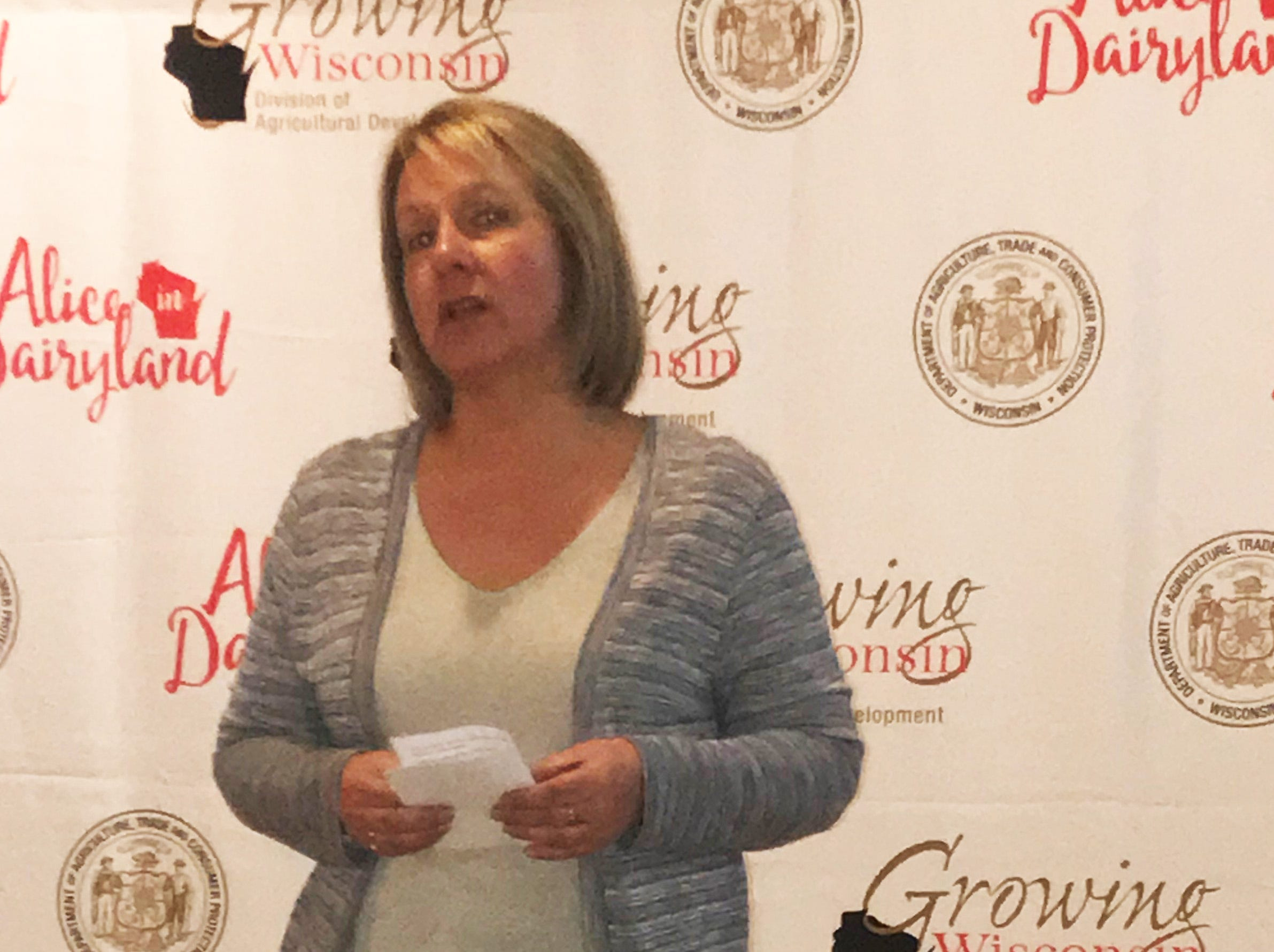 Noreen Rueckert, a member of the Green County Tourism Office welcomes guests to the March 15 press conference at the New Glarus Hotel.