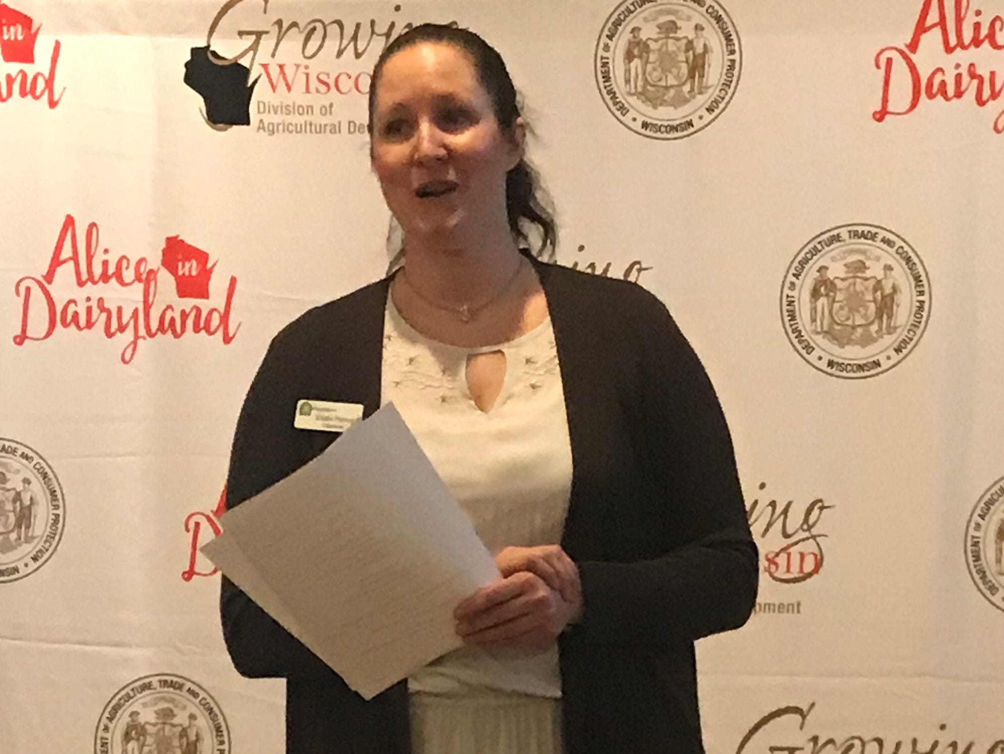 Trisha Pernot, chairman of the 2019 Alice Finals in Green County welcomes guests at the New Glarus Hotel.
