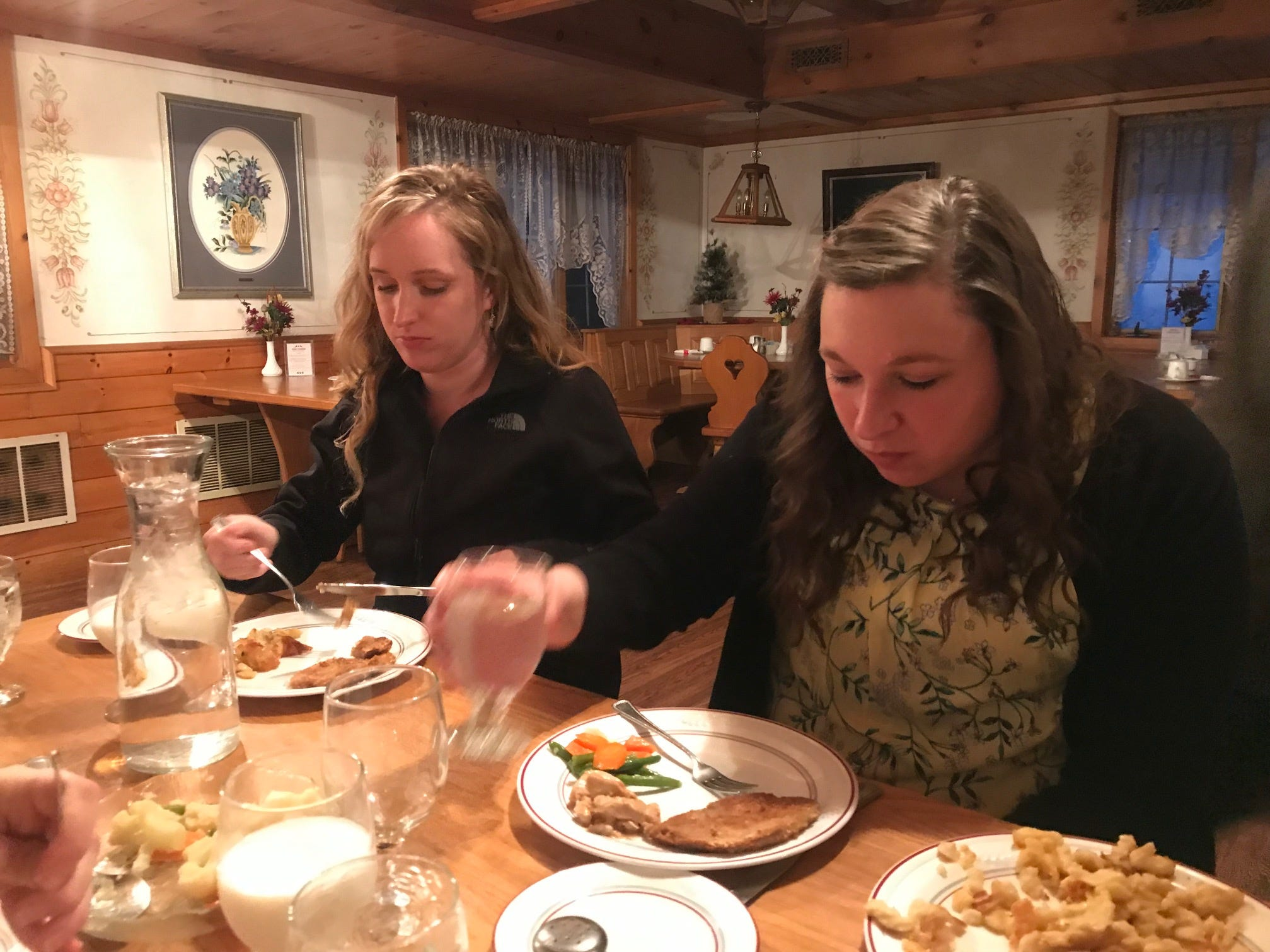 Sarah Anchenbach (left) and Tess Zettle enjoy Swiss cuisine inside the Chalet Landhaus Inn and Restaurant in New Glarus.