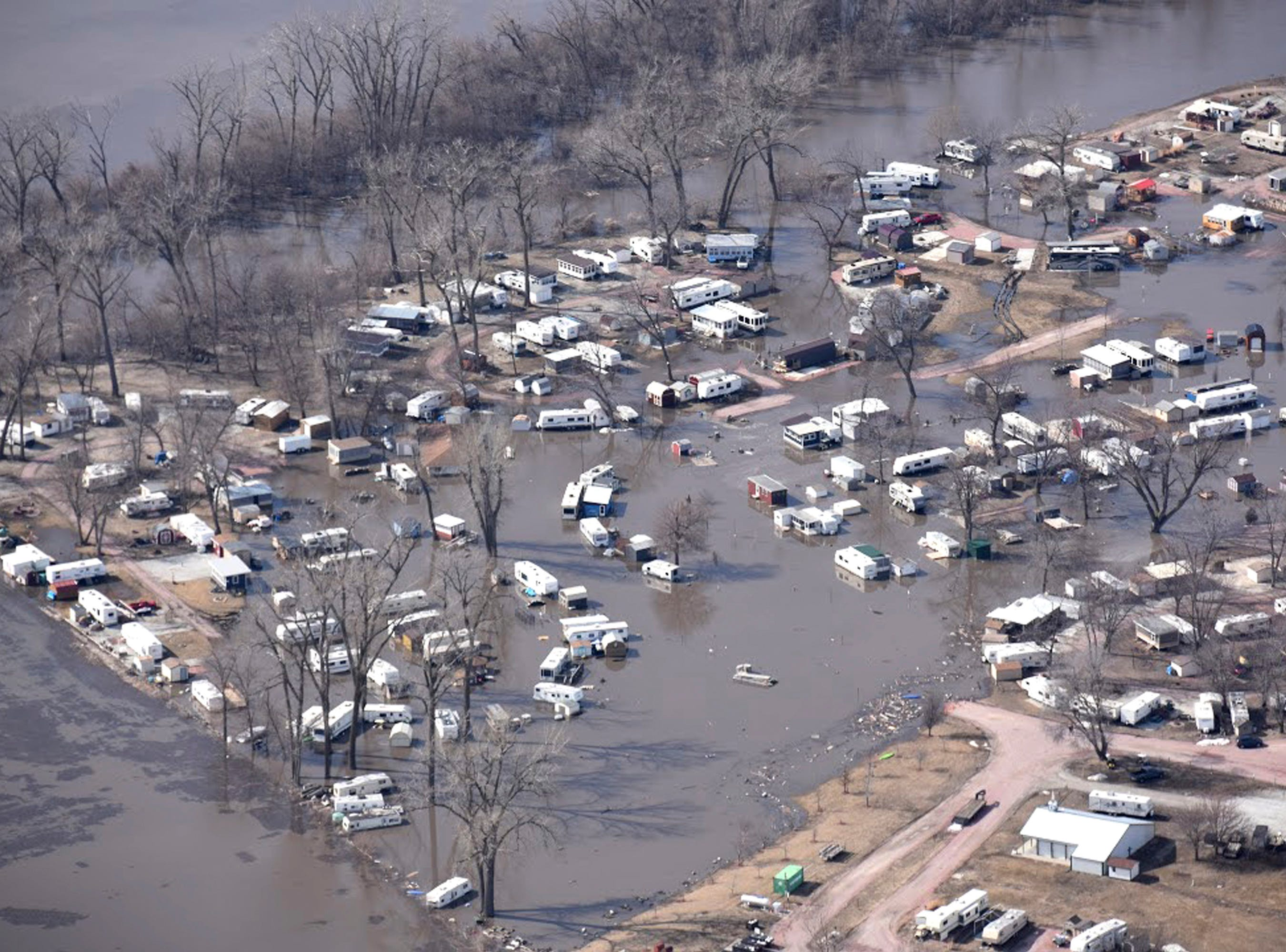 In this Monday, March 18, 2019, photo taken by the South Dakota Civil Air Patrol and provided by the Iowa Department of Homeland Security and Emergency Management, shows flooding along the Missouri River in River Sioux, Iowa.