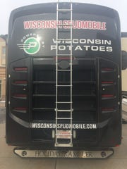 """The back of the Spudmobile, which is a 2012 Holiday Rambler Ambassador, is now a classy black that makes the name, website and """"Powered by Wisconsin Potatoes"""" logo stand out for all to see."""