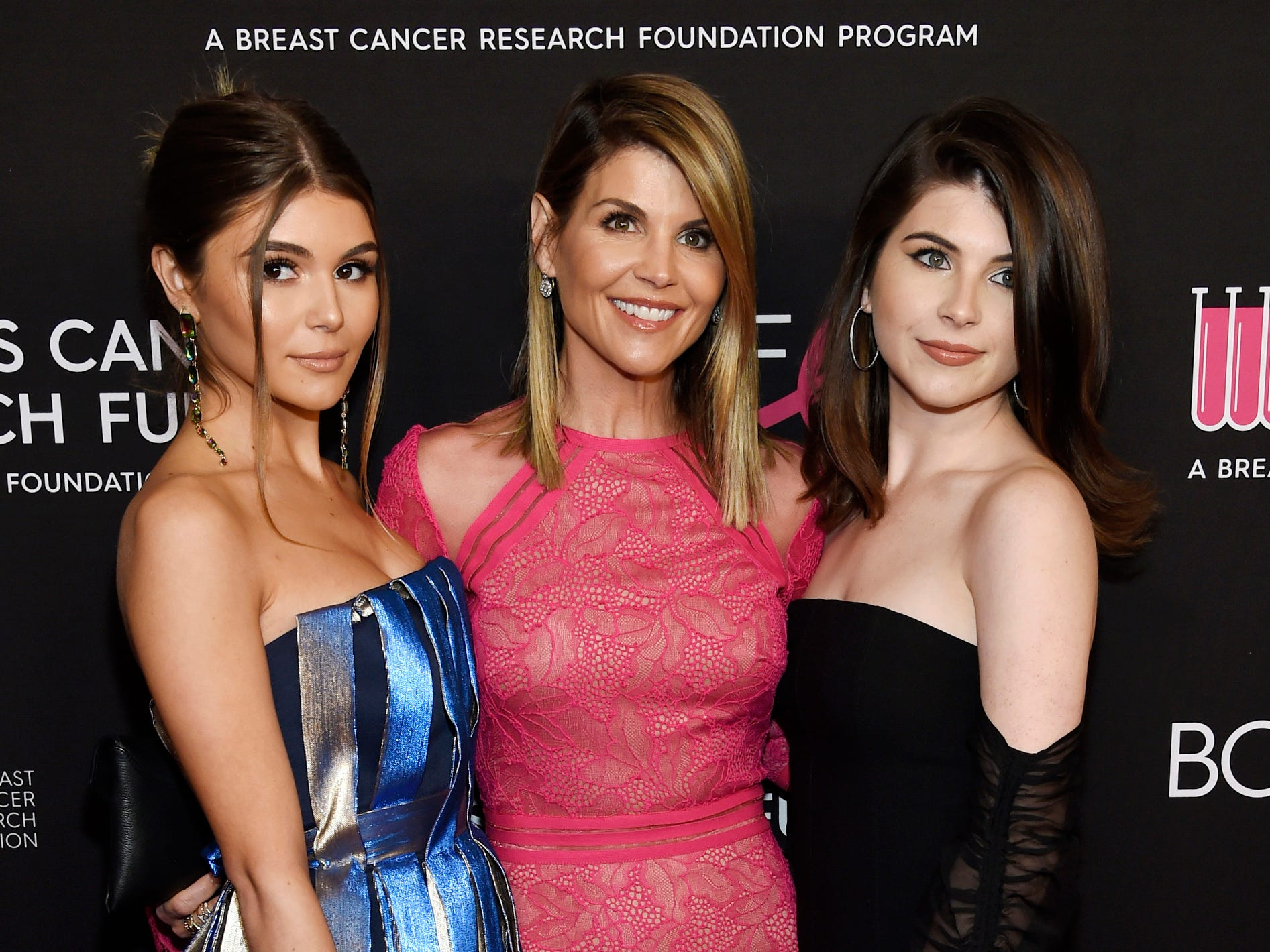 """Lori Loughlin, center, with daughters Olivia Jade Giannulli, left, and Isabella Rose Giannulli at the 2019 """"An Unforgettable Evening"""" in Beverly Hills, Calif. on Feb. 28, 2019."""