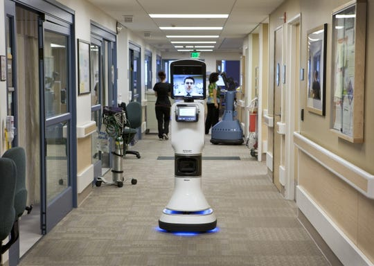 This robot brings your doctor right to you. It's a telemedicine robot with an auto-drive function that allows it to navigate its way to the patient's room. It  uses sensors to avoid bumping into things or people.