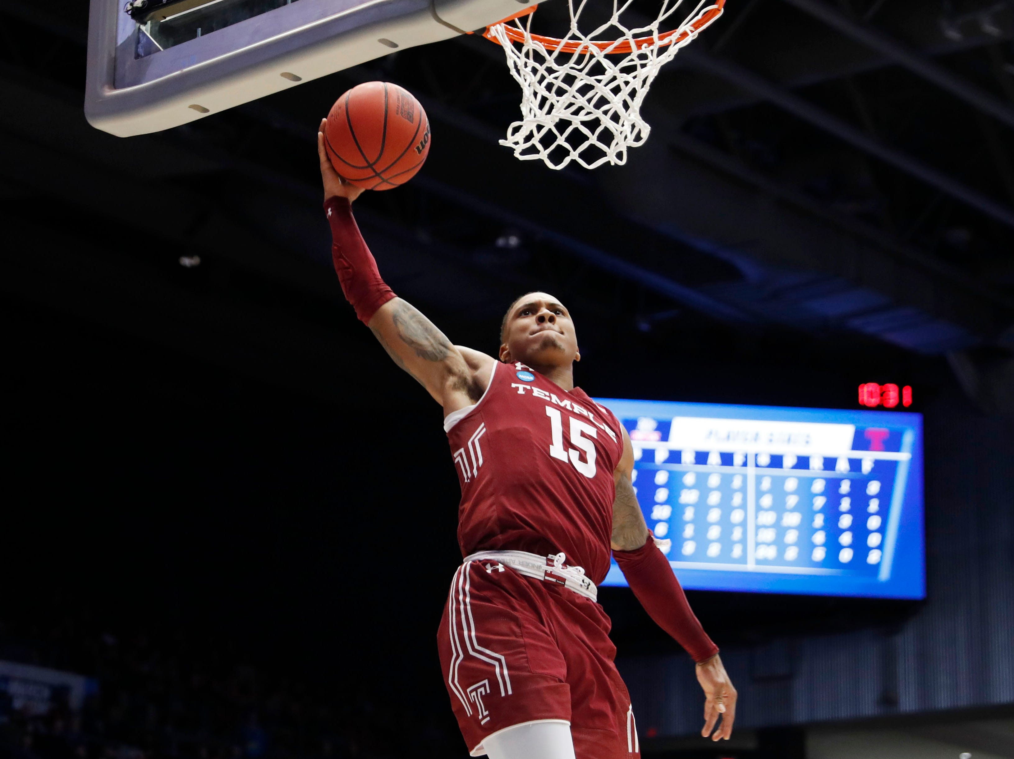 Temple Owls guard Nate Pierre-Louis dunks in the second half against the Belmont Bruins.