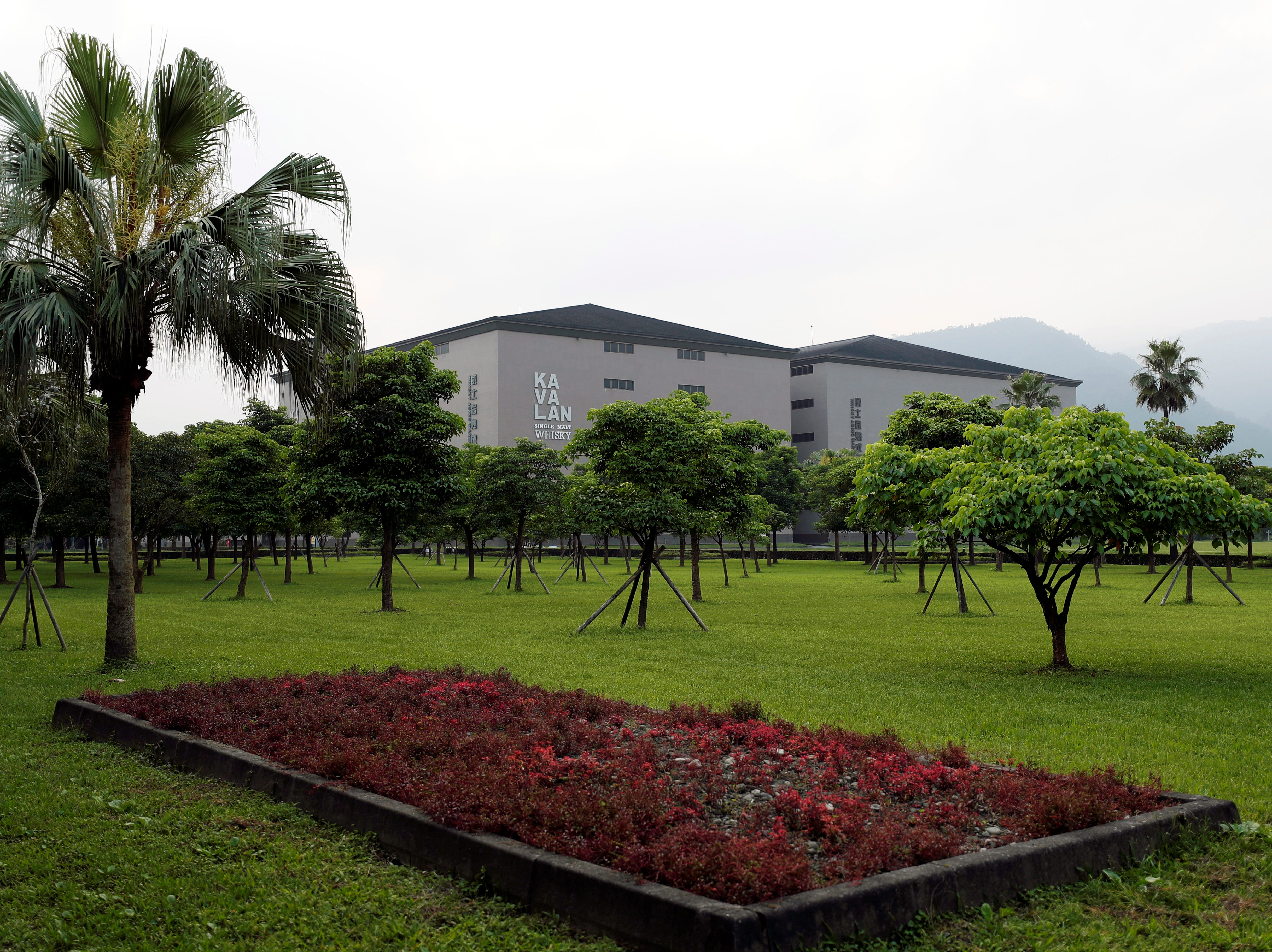 epa07449503 Trees surround the Kavalan Distillery building in Yuanshan, Yilan County, Taiwan, 18 March 2019 (issued 20 March 2019). Taiwan is located far away from traditional producers of whiskey, where the natural conditions and climate are seen as unconducive to making fine whiskey. Taiwanese whiskey brand Kavalan, broke many stereotypes, including the need for long aging, the replication of the Scottish climate and most of the industry's common practices to produce its whiskey.  EPA-EFE/RITCHIE B. TONGO ORG XMIT: _XRI7333