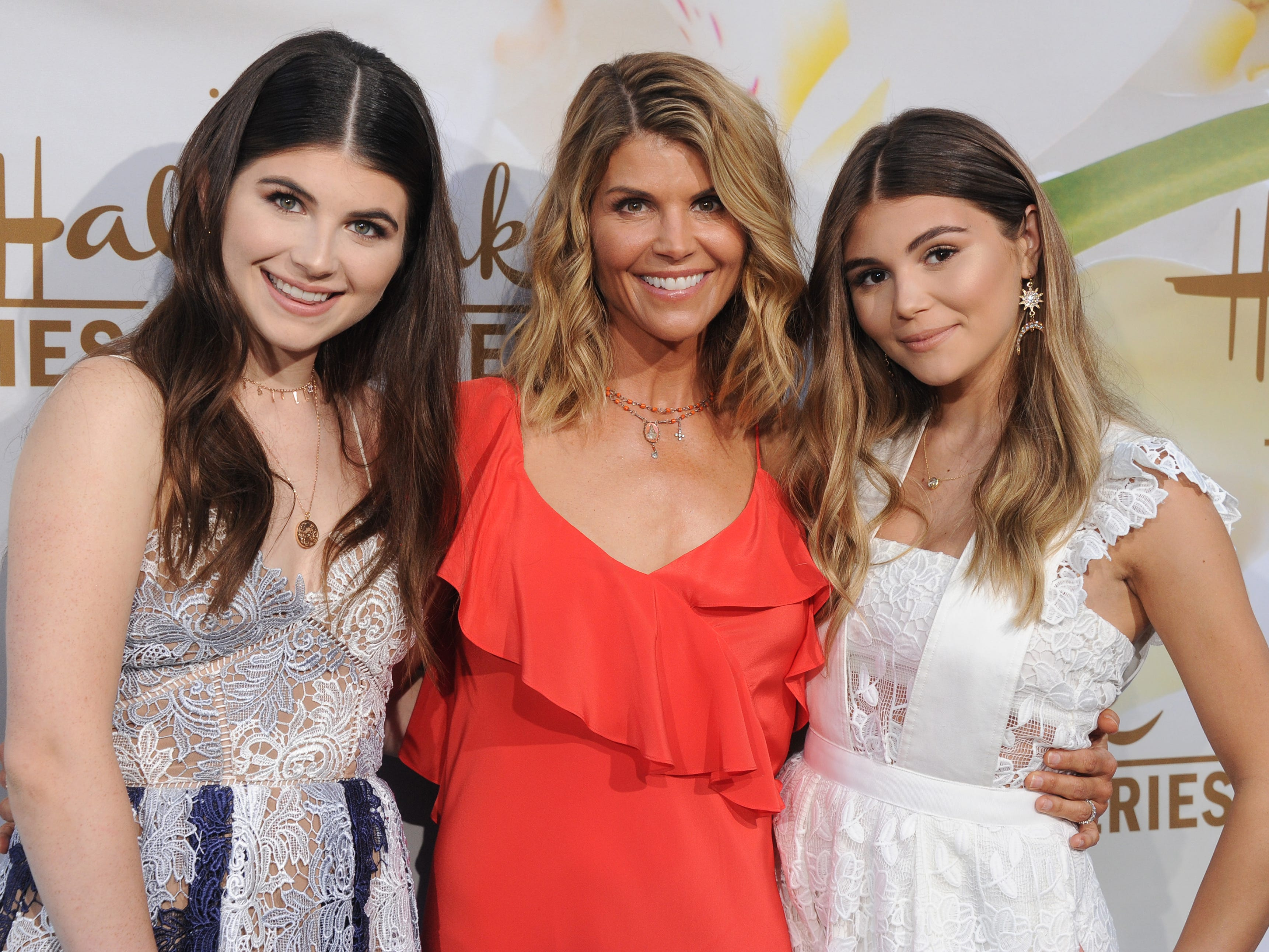 Isabella Rose Giannulli, left, Lori Loughlin and Olivia Jade Giannulli, right, arrive at the 2017 Summer TCA Tour - Hallmark Channel and Hallmark Movies and Mysteries at a private residence on July 27, 2017, in Beverly Hills, Calif.