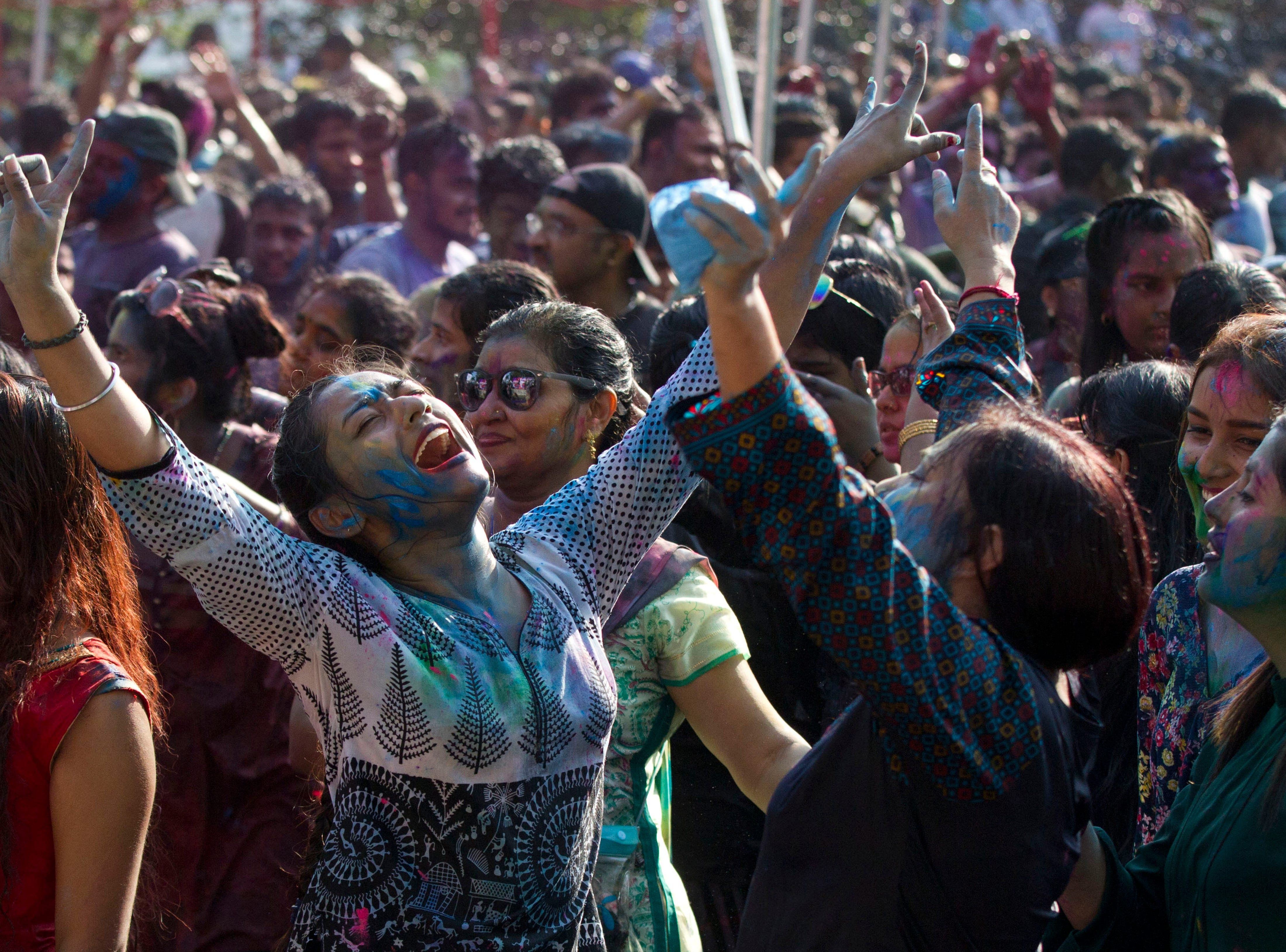 Revelers dance as they celebrate Holi, also known as the Festival of Colors, organized by the Hindu community at a park Wednesday, March 20, 2019, in Yangon, Myanmar.