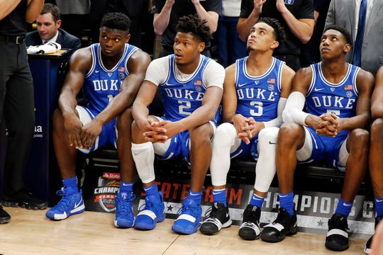 Duke Blue Devils freshmen wait to be introduced as starters in player introductions before playing against the Kentucky Wildcats during the Champions Classic at Bankers Life Fieldhouse.