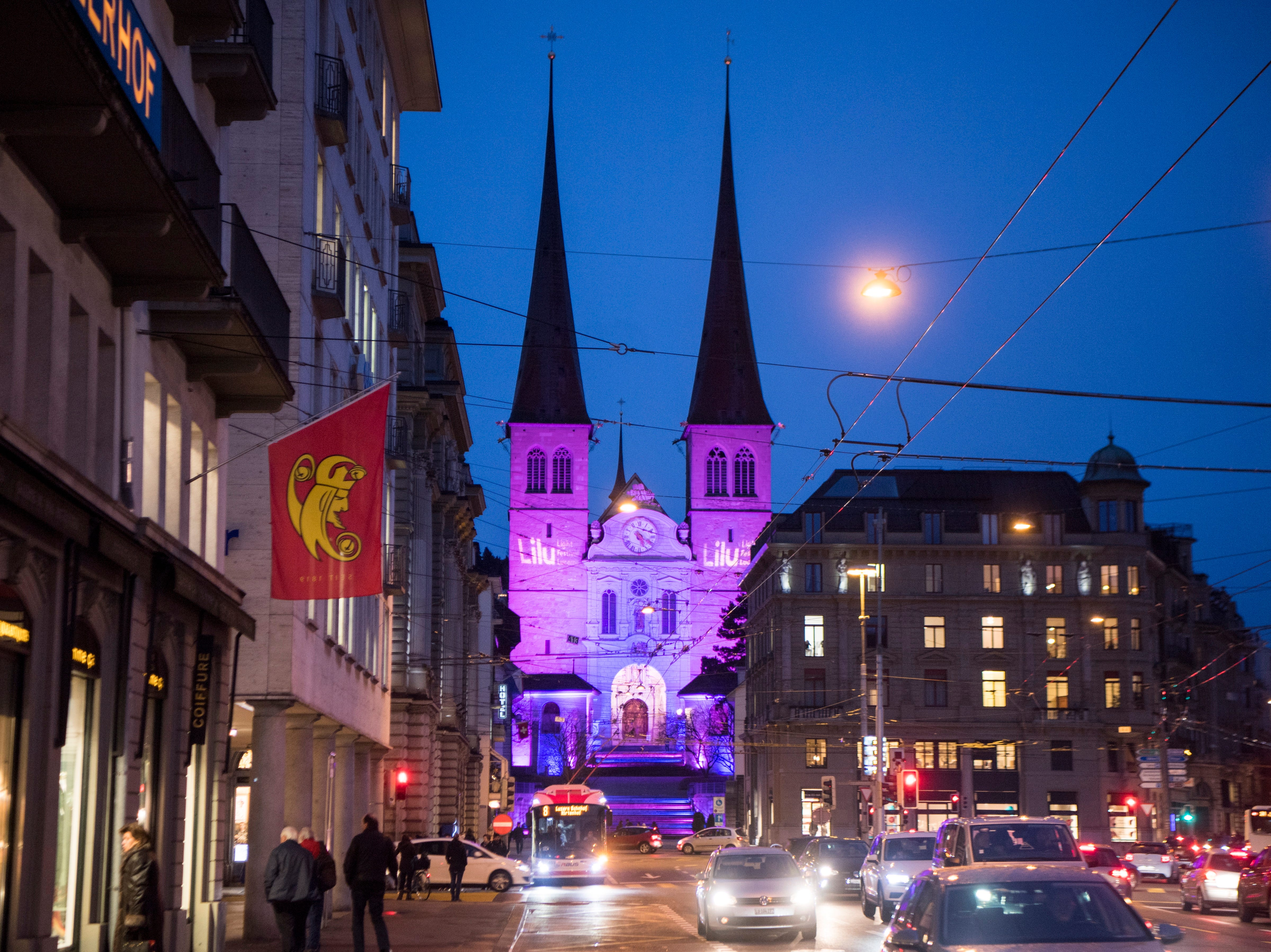 epa07271995 A view of the illuminated Hofkirche church during the pre-opening of the Lilu Light Festival Luzern, in Lucerne, Switzerland, 09 January 2019. Around 17 light art projects will be presented at the festival from 10 to 20 January.  EPA-EFE/URS FLUEELER ORG XMIT: LFE100