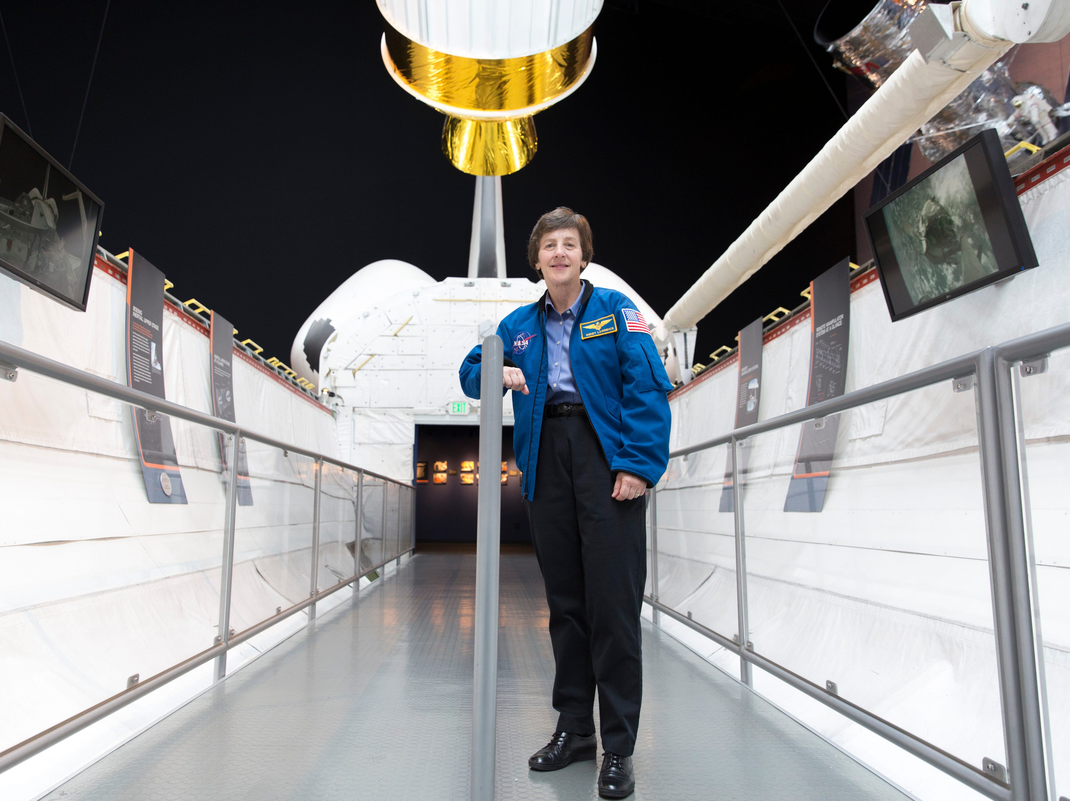 Wendy Lawrence, 58, a retired US Navy captain and former NASA astronaut, is pictured on the Space Shuttle trainer that was used for astronaut's training at the Museum of Flight in Seattle, Washington, February 28, 2018.