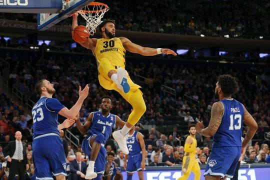 Marquette Golden Eagles forward Ed Morrow (30) dunks against Seton Hall during the semifinal of the Big East tournament. Seton Hall won 81-79.