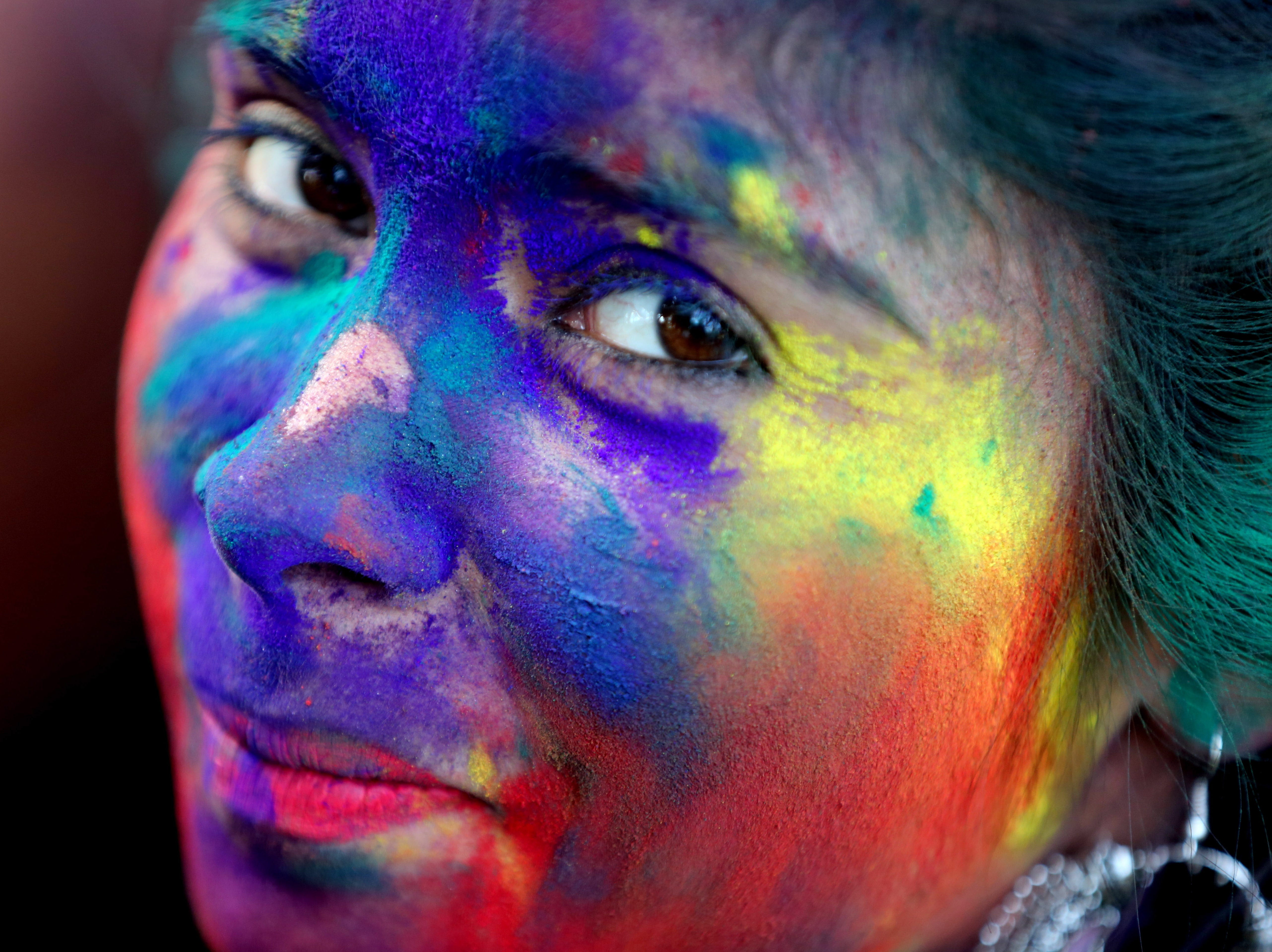 A girl takes part in the Holi festival celebrations in Bhopal, India on March 19, 2019. Holi is celebrated on the full moon day and marks the beginning of the spring season. Holi will be celebrated as the Hindu spring festival of colors across the country on March 21.