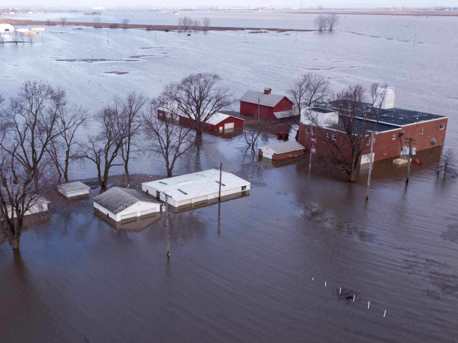 Flood waters surround homes and farmland outside of Glenwood Neb.  March 20, 2019.