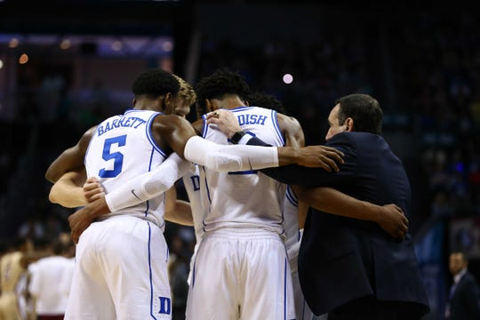 The Duke Blue Devils huddle up in the second half against the Florida State Seminoles in the ACC conference tournament at Spectrum Center.