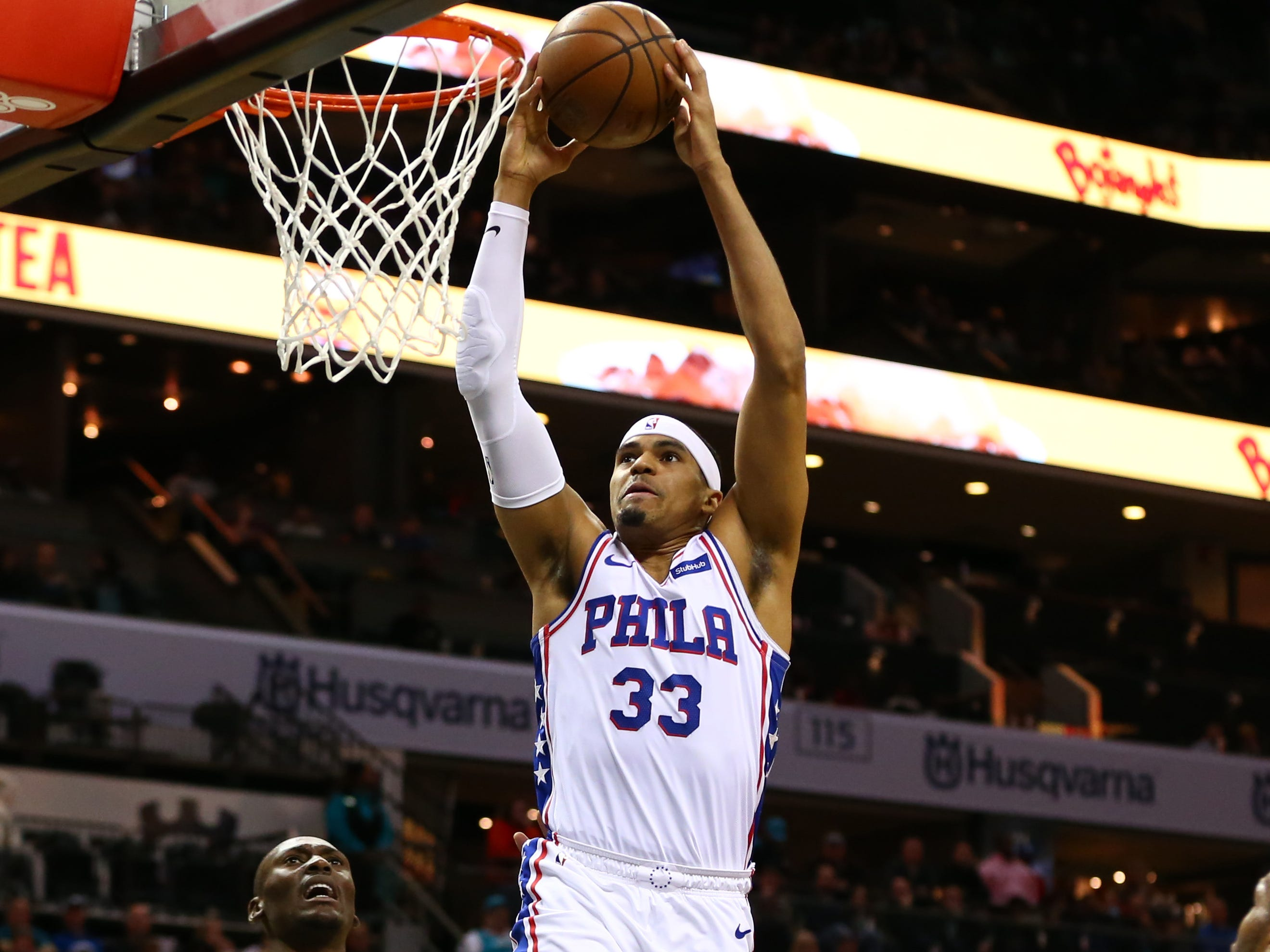 March 19: Sixers forward Tobias Harris rises up for the two-handed slam against Hornets in Charlotte.