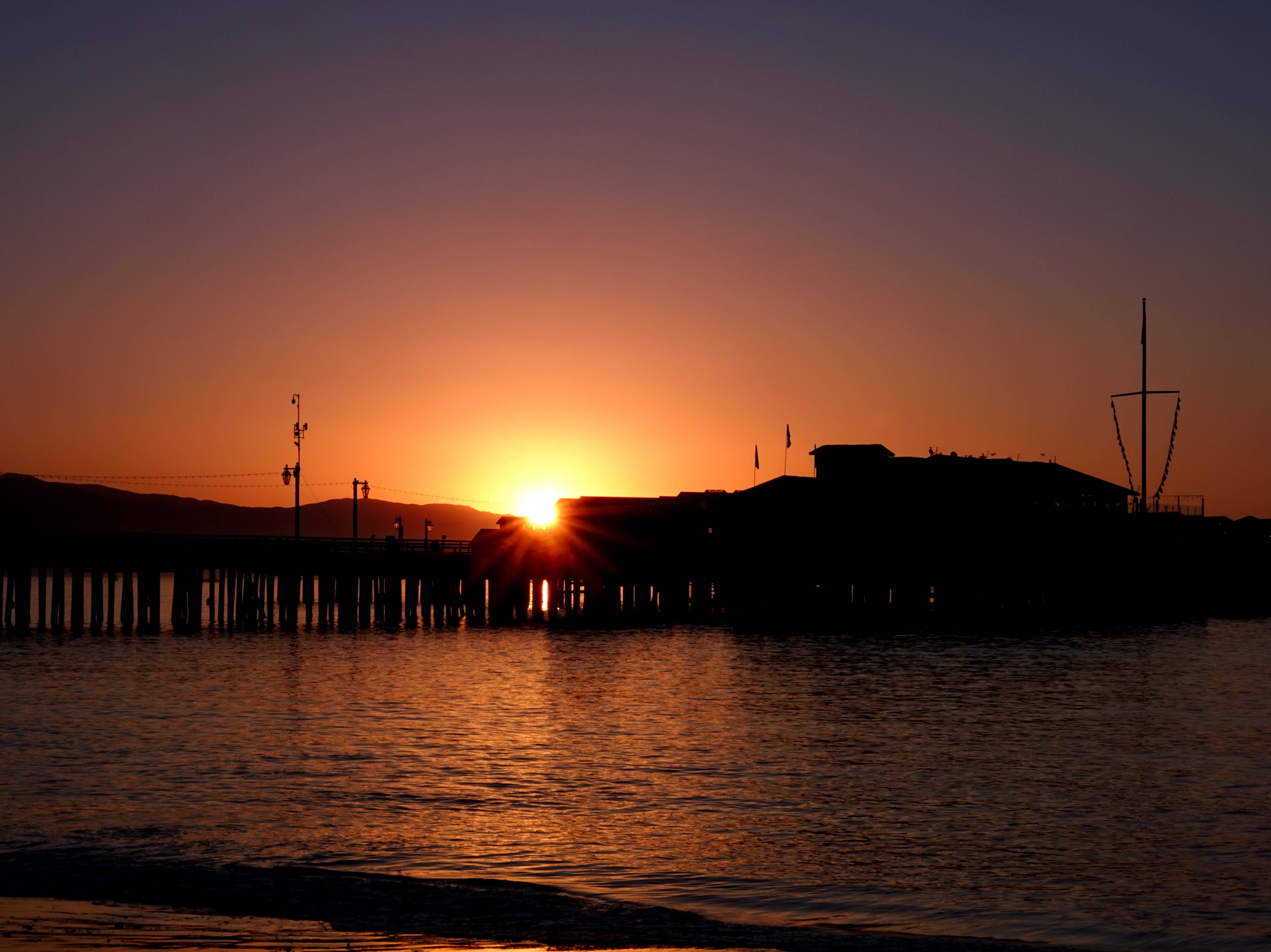 The sun rises over Stearns Wharf.