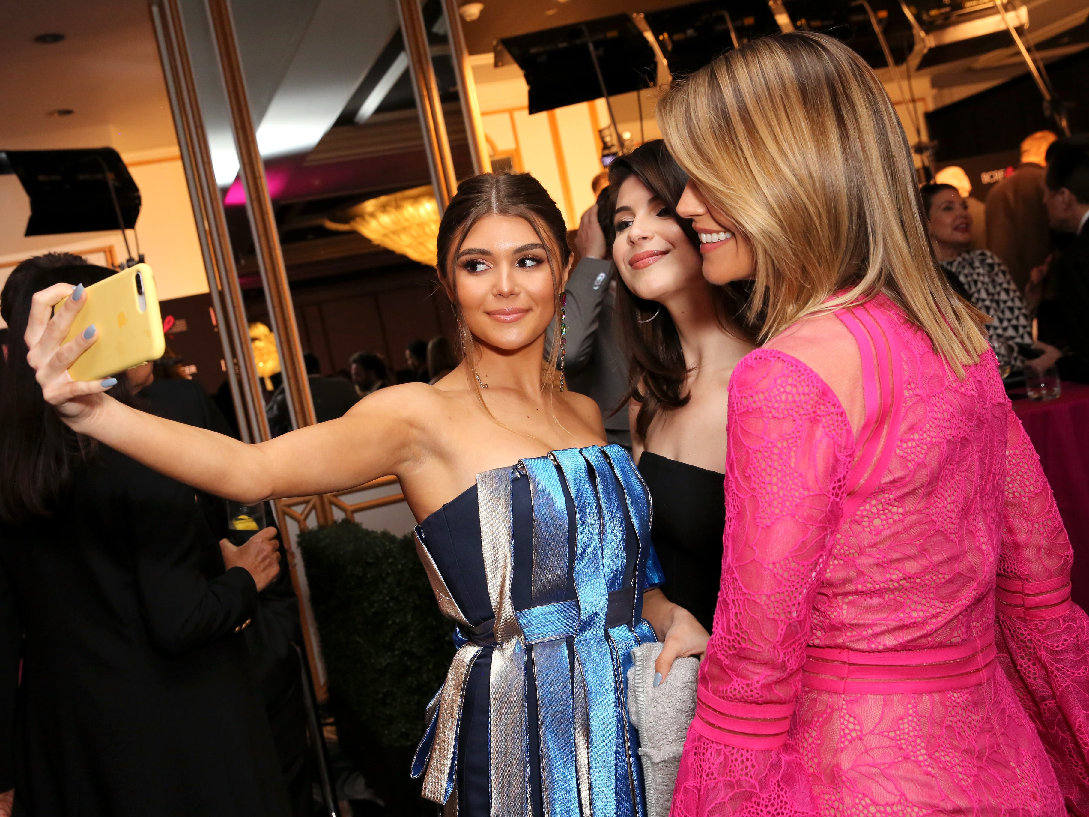 """Olivia Jade Giannulli, left, Isabella Rose Giannulli and Lori Loughlin, right, attend WCRF's """"An Unforgettable Evening"""" at the Beverly Wilshire Four Seasons Hotel on Feb. 28, 2019, in Beverly Hills, Calif."""