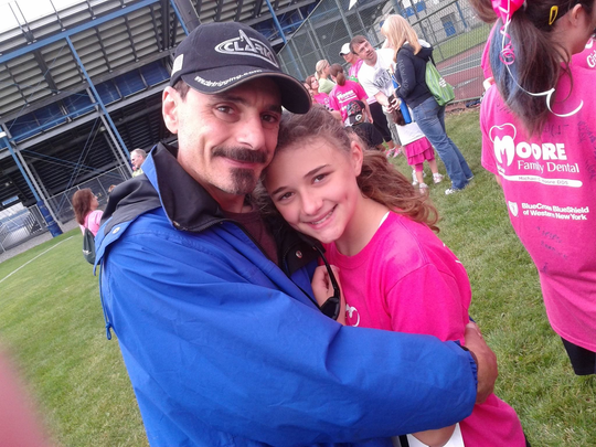 Rob Agnello of Grand Island, N.Y. is shown with his daughter, 14, who died by suicide in December 2015.