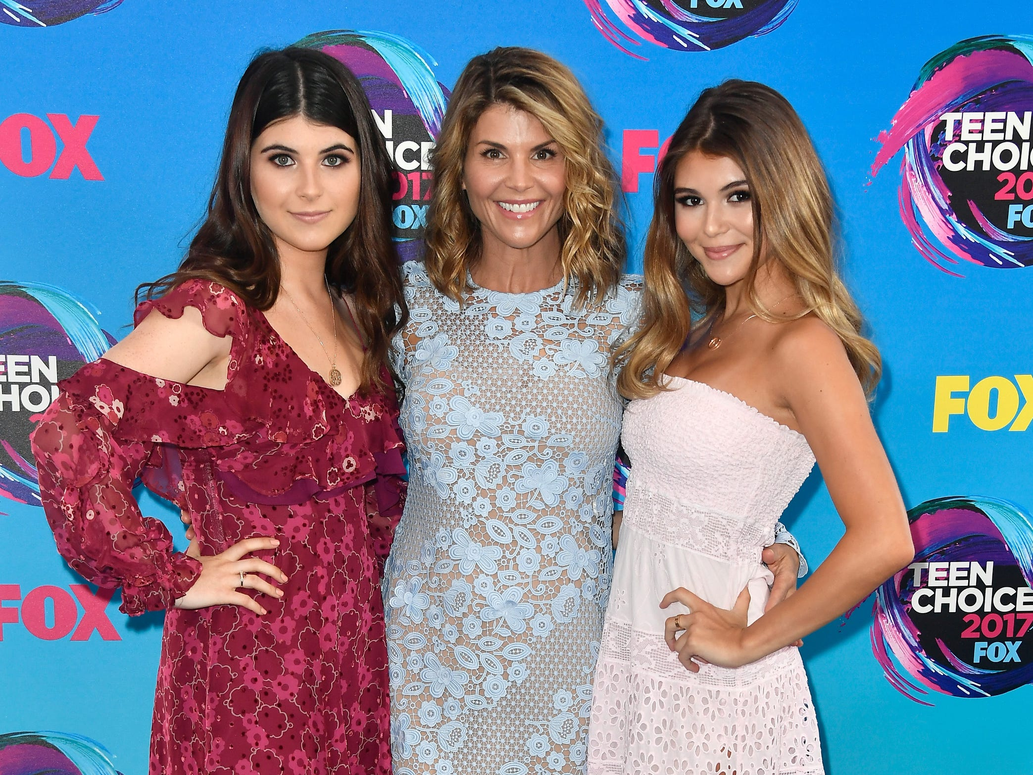 Isabella Giannulli, left, Lori Loughlin and Olivia Giannulli, right, attend the Teen Choice Awards 2017 at Galen Center on Aug. 13, 2017, in Los Angeles.