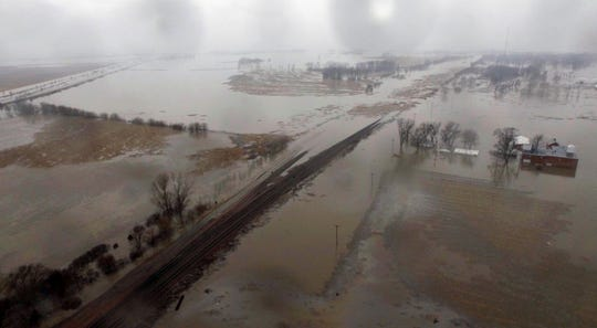 This March 19, 2019, aerial photo shows flooding along the Missouri River in Pacific Junction, Iowa. The U.S. Army Corps of Engineers says rivers breached at least a dozen levees in Nebraska, Iowa and Missouri.