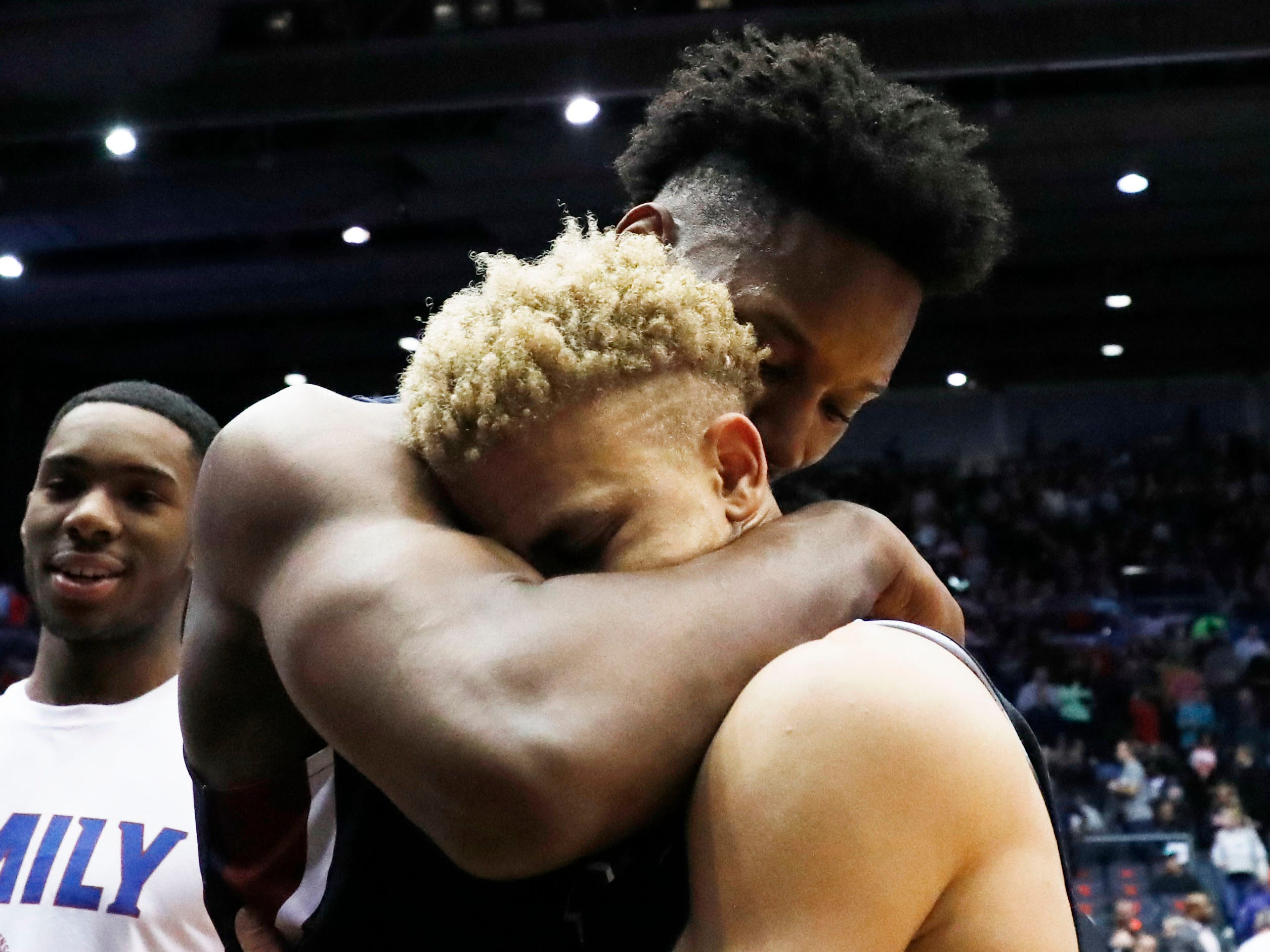 Fairleigh Dickinson Knights forward Mike Holloway Jr., left, and guard Jahlil Jenkins hug after defeating the Prairie View A&M Panthers in the First Four.