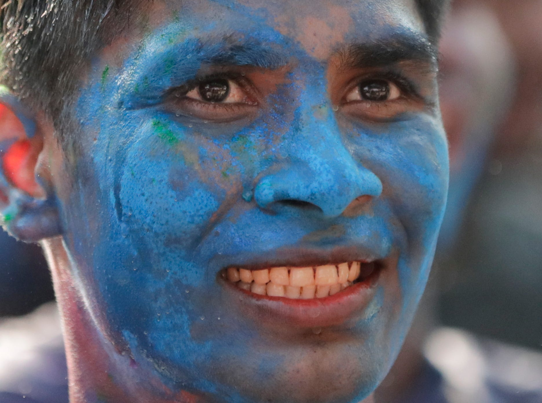 A Hindu boy with his face smeared with colored powder takes part of the Holi festival celebrations in Yangon, Myanmar on March 20, 2019.