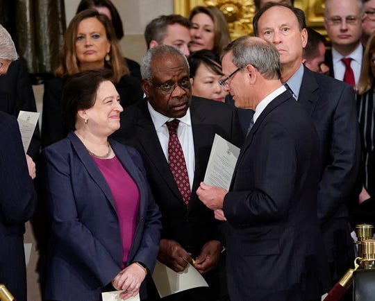 Supreme Court Associate Justice Clarence Thomas, center, at the funeral service for former President George H.W. Bush in December. Thomas spoke in court Wednesday for the first time in three years.