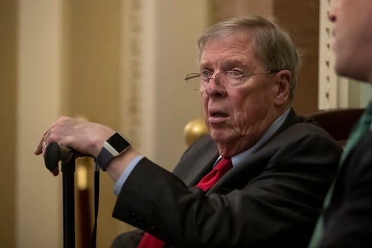 "Republican Senator from Georgia Johnny Isakson outside the Senate floor at the US Capitol in February 2019. Isakson told The Bulwark that President Donald Trump is to get a ""whipping"" over comments he made about the late Sen. John McCain."