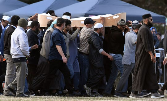 Mourners on March 20, 2019, attend a funeral for a victim of the twin mosque attacks in Christchurch, New Zealand.