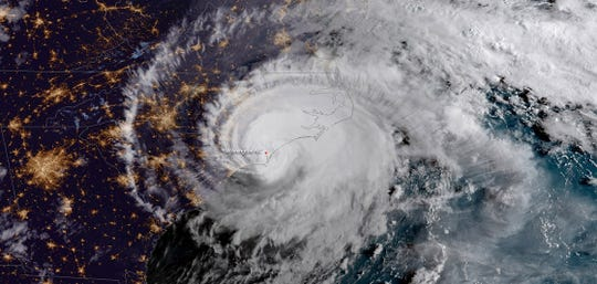A satellite image shows Hurricane Florence lashing the Carolinas in September 2018.