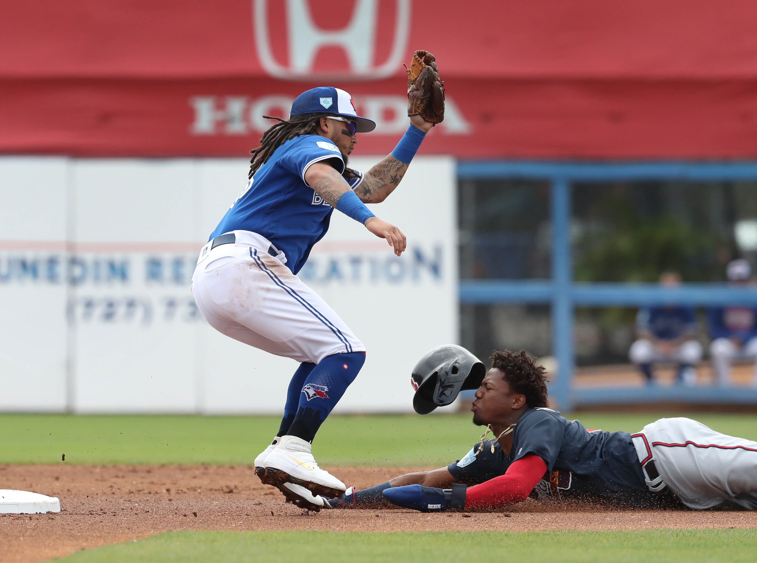March 20: Braves outfielder Ronald Acuna Jr. steals second base as Blue Jays shortstop Freddy Galvis goes for the tag.