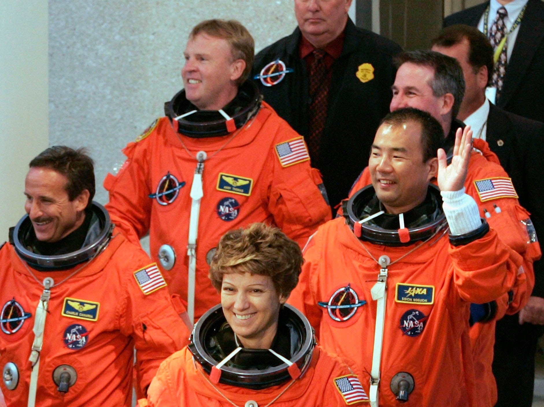 Space Shuttle Discovery astronauts Charles Camarda, Andrew Thomas, commander Eileen Collins, Soichi Noguchi, of the Japanese space agency JAXA, and Stephen Robinson, (L to R) wave to NASA workers before being loaded into the astronaut van to be driven to launch complex 39-B.